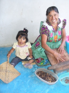 Sofía making chocolate with granddaughter Elena in San Miguel del Valle