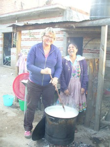 Stirring the atole with Bertha