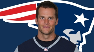 New England Patriots QB Tom Brady, under fire for possible football deflating