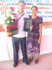 "Hugo with mom Lupita at his high school graduation in 2013. I was his ""sponsor,"" which meant I provided flowers and walked across the stage with him."